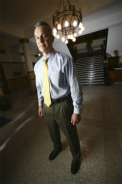 Special Agent Phil Niedringhaus (above) runs an FBI task force that cracks bank robbery cases like the ones involving the Snowboard Bandits (right).