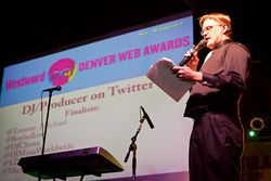 Brian Landis Folkins, the 2011 Denver Web Awards emcee, announces the winner for best DJ/Producer on Twitter, on Wednesday, November 16, 2011 at Casselman's. More Photos: 2011 Denver #WebAwards party