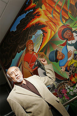 Artist Leo Tanguma doesn't understand how conspiracy theorists find hidden messages in his mural on environmentalism.