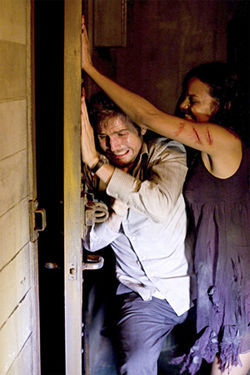 Michael Stahl-David and Jessica Ford escape from monsters in Cloverfield.