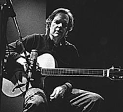 Leo Kottke keeps playing his quirky tune.