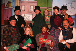 The cast of Ebenezer offers excess Christmas cheer.
