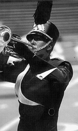 Johnny, blow your horn: A trumpet-tooting member of the Blue Knights marching band.