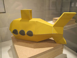 """Yellow Narco Submarine,"" by Rafael Fajardo, assembled cut paper."