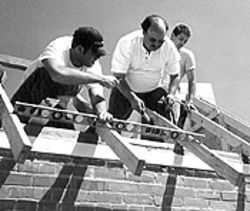 John Hopper (center) and his students spent countless hours over the spring and summer building a new roof.