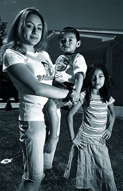 Rude awakening: Kenia (holding her little brother) and 