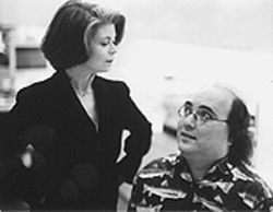 Head hunter: Helen Shumaker looks down on Josh Kornbluth in Haiku Tunnel.