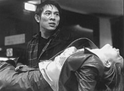 Jet Li helps Bridget Fonda out of the frying pan in Kiss of the Dragon.
