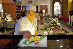 Chef Eddie Wang puts the finishing touches on a Japanese crab omelet at Hana Matsuri.