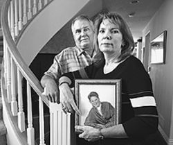 Curt and Pat Jensen hold a picture of their only son,  Erik, before he and Nate Ybanez were convicted of  first-degree murder.