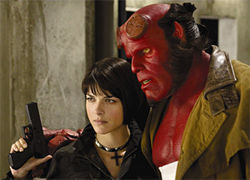 Selma Blair and Ron Perlman support each other in Hellboy II.