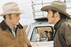 Heath Ledger and Jake Gyllenhaal get ready to  saddle up in Brokeback Mountain.