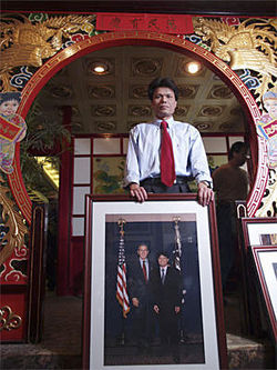 Dan Tang at Heaven Dragon in 2004 with a photo of George Bush.
