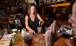 Rodney&#039;s bartender Christy Wukovits. See a full slideshow from inside Rodney&#039;s.
