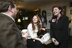 House Minority Leader Mike May chats with Miller (center) and Hasan campaign manager Callie Carey (right) in early December.