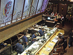 The cooks are just one of the attractions at the stunning Izakaya Den.