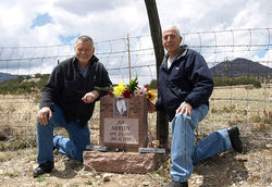 Author Robert Perske (left) and attorney David Martinez, who won a posthumous pardon for Arridy in 2011, visit his grave on Woodpecker Hill outside Ca&amp;ntilde;on City.