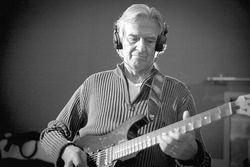 Playing guitar is a spiritual thing for John McLaughlin.