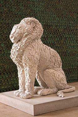 """Wolfgang's Lion"" in front of ""Half Arch,"" by Kim Dickey, mixed materials."