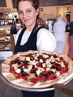 The mystery of pie: Marisa Cantarovici displays one  of A La Tomate's tartes.