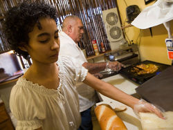 Sussette and Enrique Rosell work on an asere sandwich at La Guarida Cubana.