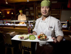 Chef Ben Liu serves up scallop at Land of Sushi. More Land of Sushi photos.