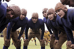 George Clooney (center) leads a team in Leatherheads.