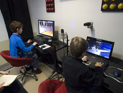 Spencer and Braxton Jones test-drive LEGO Universe in the NetDevil studio.