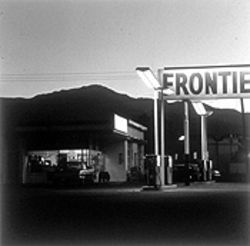 """'Frontier' Gas Station and Pike's Peak, Colorado Springs,"" by Robert Adams, gelatin silver print."