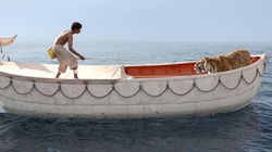 Suraj Sharma and a tiger star in Life of Pi.