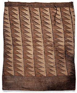 Nez Perce root bag made of woven prairie grasses.