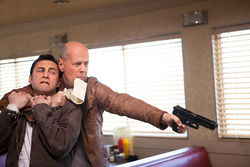 Joseph Gordon-Levitt and Bruce Willis star in Looper.