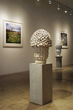 Installation view of Kim Dickey&#039;s &quot;Cold Pastoral,&quot; includes photos and ceramics.
