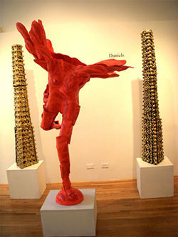"""Red Nike III"" and towers, by Martha Daniels, glazed and painted ceramics."