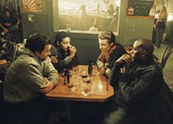 Family affair: Mark Wahlberg, André Benjamin, Garrett  Hedlund and Tyrese Gibson go frat pack in Four  Brothers.