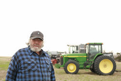 Kansas farmer Bryce Stephens had to stop growing organic corn and soybeans for fear of contamination; he's got thirty-foot buffer crops to protect his organic wheat.