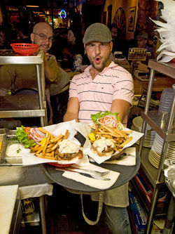 Mountain Sun general manager Mike Absalom shows off his junk...burgers. View a full slideshow from Mountain Sun Pub & Brewery in Boulder.