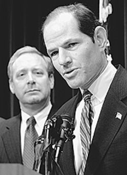 Talking trash: Microsoft attorney Brad Smith (left)  watches as New York Attorney General Eliot Spitzer  vows to delete Scott Richter's profits.