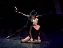 Matt Peters and Joanie Beyette work the stage in Chicago.