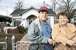 Mark and Betty Wonder in front of their family home.