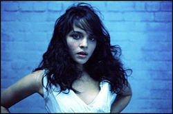 Norah Jones's lips are puffy from smooching Jude Law.