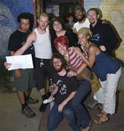 Members of the Denver Slam Team celebrate their win at  the Mercury Cafe.
