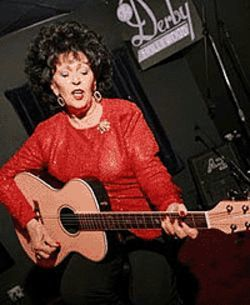 Wanda Jackson is still whoopin' it up.