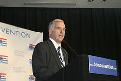 Howard Dean saluted the press at a pre-convention walk-through.