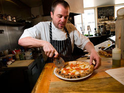 Owner Kelly Whitaker aims for the perfect pie at Pizzeria Basta.