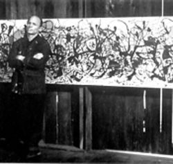 Ed Harris as Jackson Pollock pauses in front of one of the artist&#039;s breakthrough &quot;action paintings.&quot;