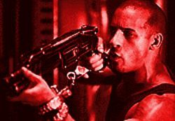 Space cadet: Vin Diesel takes aim in Pitch Black.