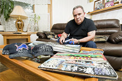 Ray Ruybal at home, with sketchbooks he&#039;s confiscated over the years.