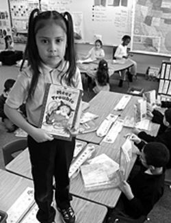 Story hour: Greenwood Elementary School first-grader  Vanessa Salazar is hooked on books.