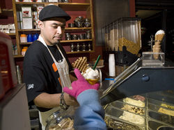 Carlos Ayala serves up some ice cream at Red Trolley.